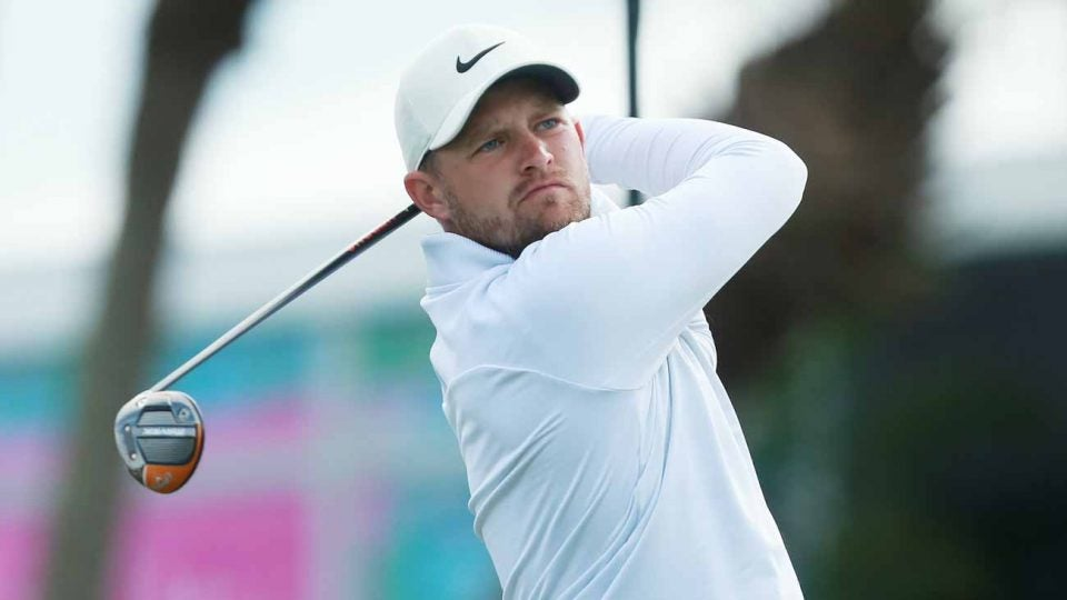 Tom Lewis hits a shot during the first round of the Honda Classic on Thursday.