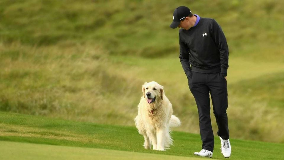 Matthew Fitzpatrick walks alongside his dog at Kingsbarns Golf Links in 2017.