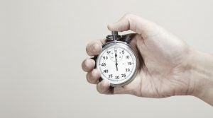 A picture of a man holding a stopwatch