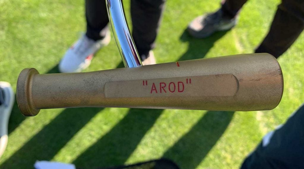 The best part of Alex Rodriguez' golf bag was hiding beneath a skinny headcover.