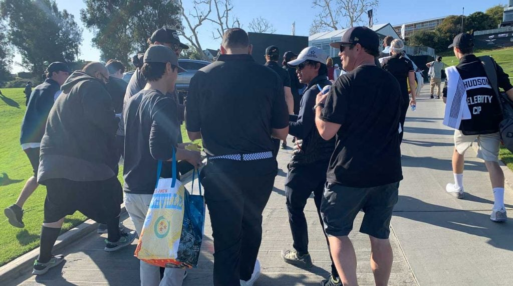 It can't be easy to focus on your golf game when you're being hounded for baseball autographs.