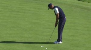 Tiger Woods misses a two-foot par putt on No. 13 on Saturday at Riviera.