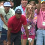 Tiger Woods and Michael Phelps stared down Woods' tee shot at No. 16 on Masters Sunday.