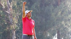 Adam Scott holds up his fist to celebrate winning the Genesis Invitational.