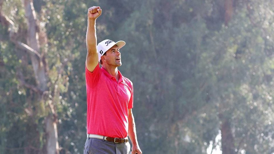 Adam Scott holds up his fist to celebrate winning the Genesis Invitational.