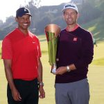 Tiger Woods presents the Genesis Invitational trophy to Adam Scott.