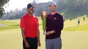 Tiger Woods presents the Genesis Invitational trophy to Adam Scott.