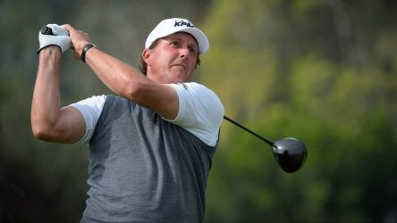 Phil Mickelson hits a drive at the Genesis Invitational.