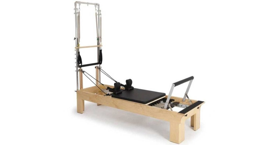 The Reformer: a torture device or surefire savior for back pain?  I was about to find out.