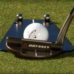 A close up of Phil Mickelson using a Pelz Putting tutor