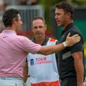 Rory McIlroy and Brooks Koepka after McIlroy won the 2019 Tour Championship