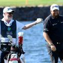 Shane Lowry shares a laugh with his caddie Bo Martin at the Saudi International.