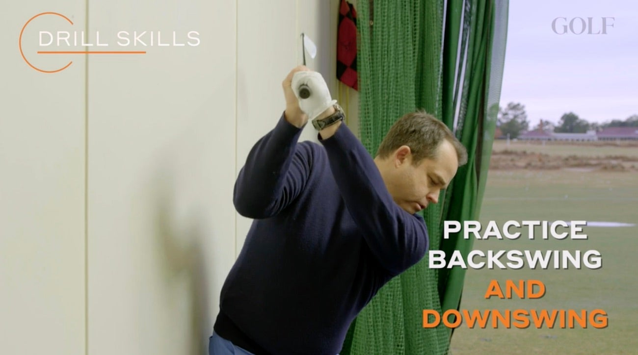 WATCH: How swinging up against a wall could improve your backswing