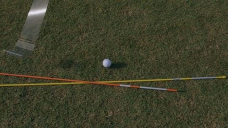 Take two alignments sticks and situate them like so to improve your slice