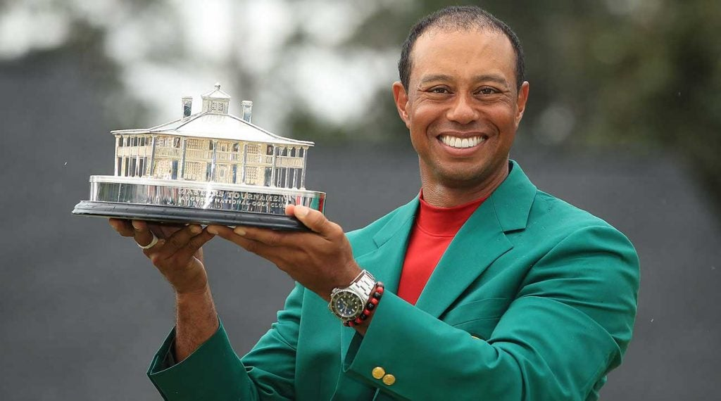 Tiger styles his Rolex watch.