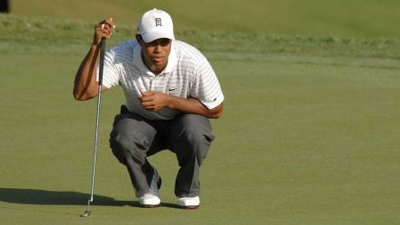 Tiger Woods reads a putt.