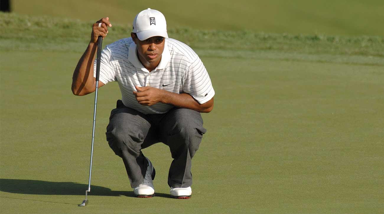 Tiger Woods reads a putt.