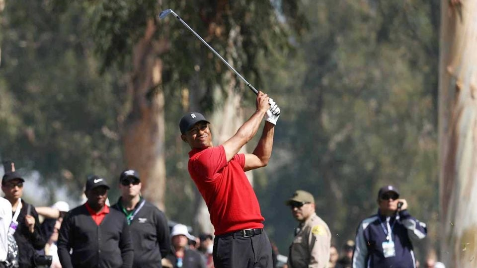 Tiger Woods hits a shot during Sunday's final round of the Genesis Invitational.