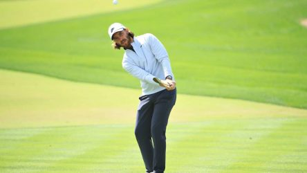 Tommy Fleetwood hits a chip at the Dubai Desert Classic.