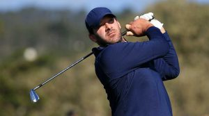 Tony Romo watches a shot during the 2020 AT&T Pebble Beach Pro-Am.