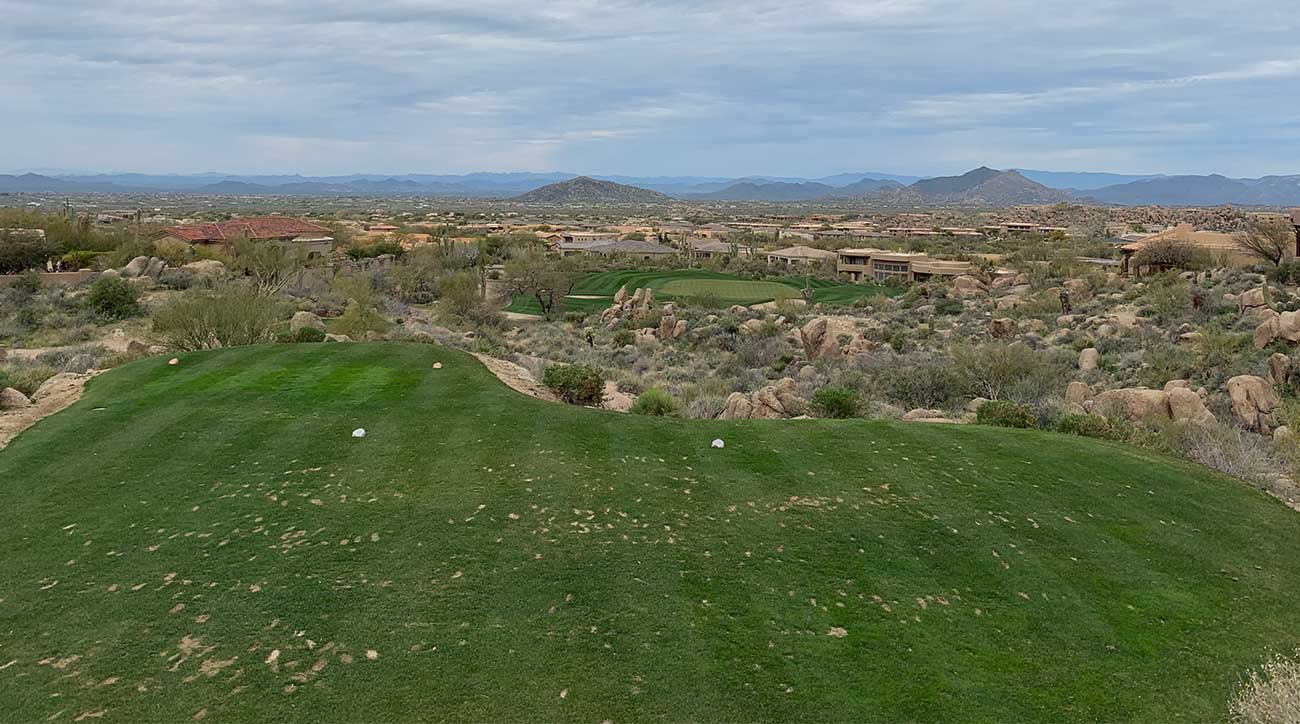 The par-3 16th at the Monument course is long, but the views from the tee box go on for miles.