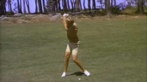 Mickey Wright at the top of her backswing.