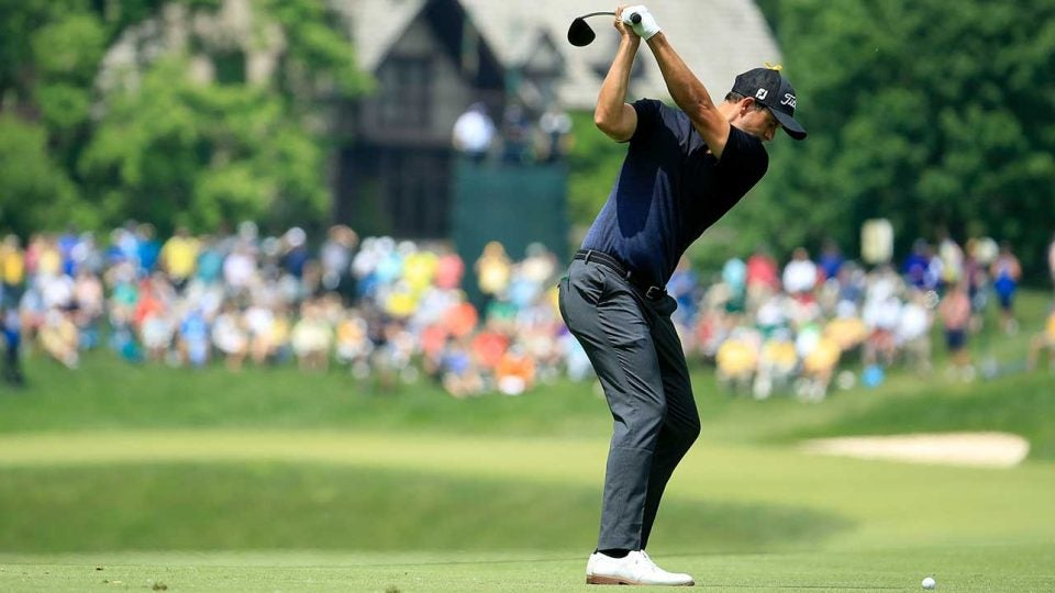 Adam Scott swings golf club