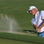 Fred couples hits a shot from the bunker at the 2020 Cologuard Classic