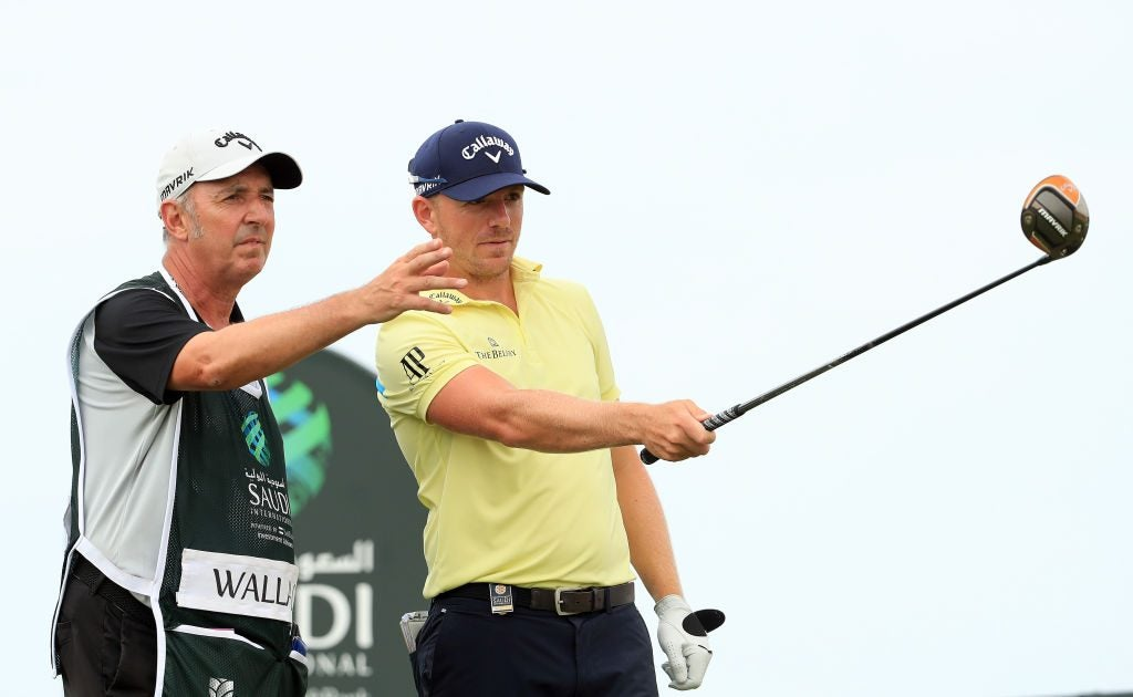 Matt Wallace and his caddie talk over a shot at the Saudi International on Jan. 31, 2020.