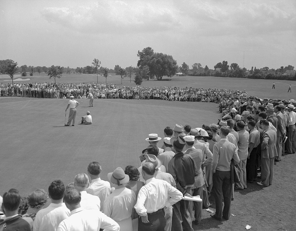 Crowd watches Ben Hogan sink a put during the final round of the Hale America Open at the Ridgemoor Country Club. Hogan, Golf's top money winner for the past three years, took the $1,000 winner's purse with 271 score for 72 holes.
