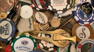 A collection of golf ball markers.