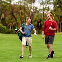 Fling golfer and regular golfer playing together