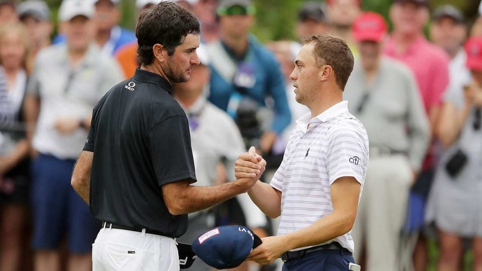 Justin Thomas and Bubba Watson shake hands after a round.