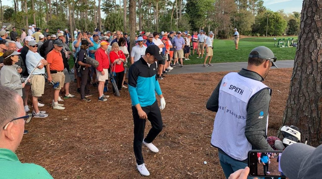 Jordan Spieth fired his opening tee shot into the woods to the right of No. 10.