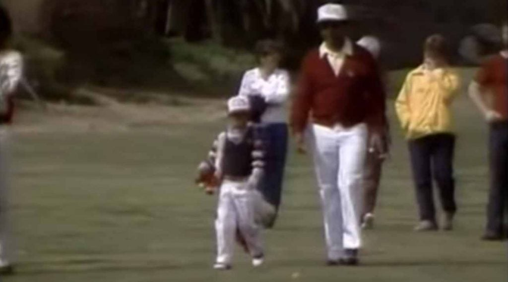 Tiger Woods and Earl Woods, walking the fairways.