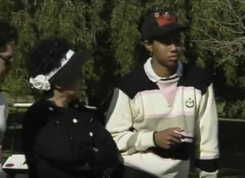 Tiger Woods (in Hurricanes hat) alongside his mother Kultida.