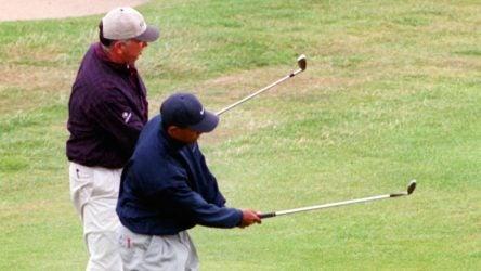 tiger woods hits golf ball