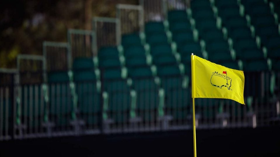 Empty grandstands and a flagstick at Augusta National