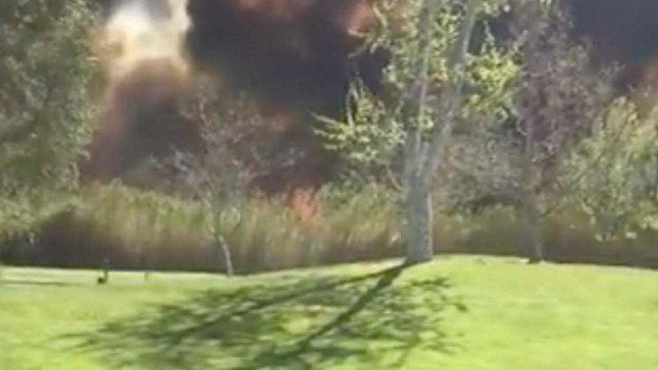 fire burns beyond the golf course