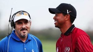David Feherty talks with Tiger Woods.