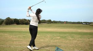woman hitting range balls