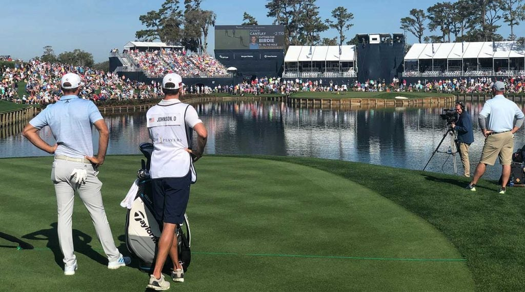 Dustin Johnson prepares to tee off at the famed 17th hole at the Players Championship shortly before the PGA Tour announced its decision to ban fans from entering for the remainder of the week.