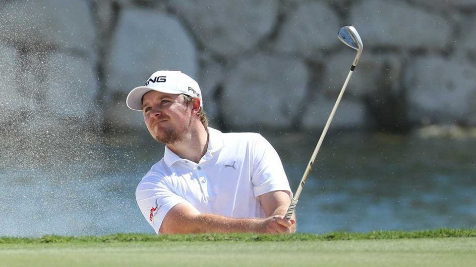 Eddie Pepperell hits out of a bunker during the first round of the Qatar Masters on Thursday.