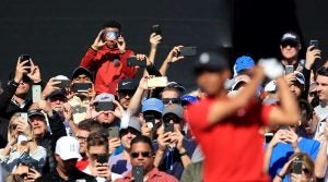Tiger Woods fans taking photographs