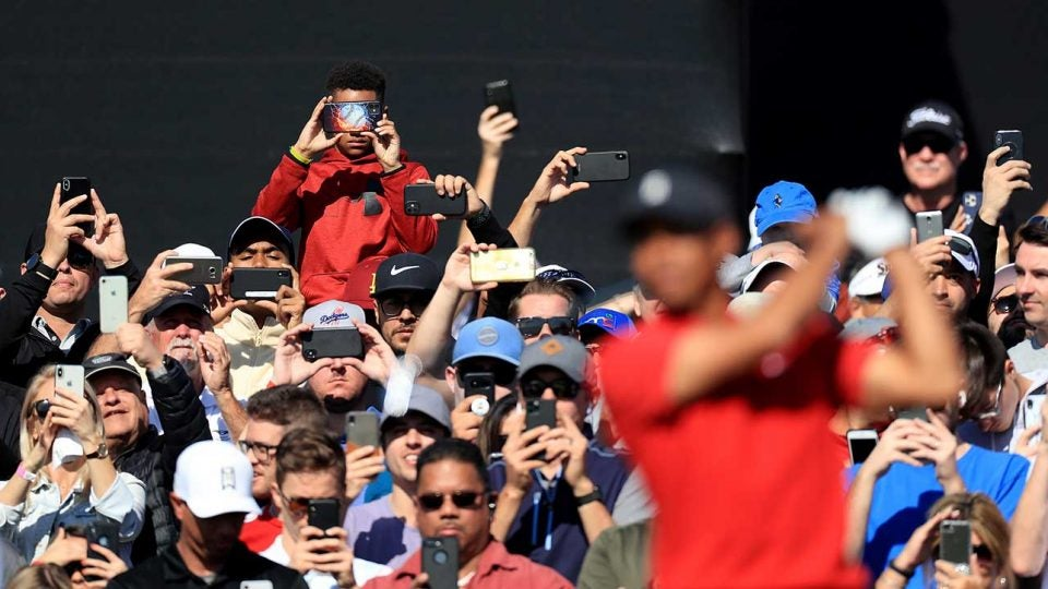 Tiger Woods fans taking photographs