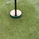Raised cup golf hole