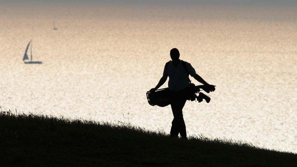 golfer walking alone