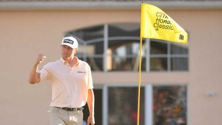 Mackenzie Hughes pumps his fist after making a putt during the final round of the Honda Classic.