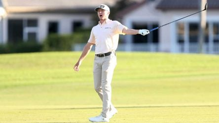 Mackenzie Hughes watches his second shot on the 18th hole sail into the grandstands at the Honda Classic on Sunday.
