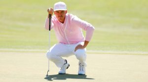 rickie fowler reading a putt